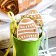 Bucket of gingerbread easter cookies on rustic table — Stock Photo #27641235
