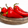 Red hot chili peppers in wooden bowl isolated on white — Stock Photo