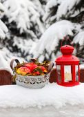 Bucket of apples and red lantern, winter garden decor — Stock fotografie