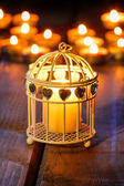 Oriental lantern on wooden table in the evening. Selective focus — Stock Photo