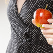 Young girl holding an apple — Stock Photo