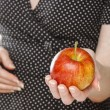 Stock Photo: Young girl holding an apple