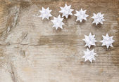Paper stars on wooden rough background. Copy space — Stock Photo