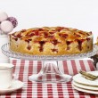 Stock Photo: Strawberry pie on cake stand, white background, copy space
