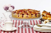 Strawberry pie on cake stand, white background, copy space — Stock Photo