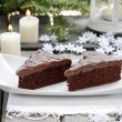 Danish traditional christmas. Chocolate cake and white handmade  — Stock Photo