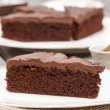 Stock Photo: Chocolate cake on white plate, on hessian.