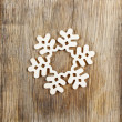 Snowflake made of wood on wooden background — Stock Photo