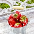 Silver bucket of strawberries — Stock Photo