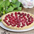 Raspberry tart on wooden table — Stock Photo