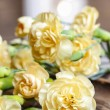 Yellow carnation flowers on wooden background. Selective focus — Foto de Stock