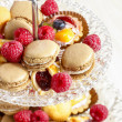 Parisian macarons, raspberries and other delicacy. Closeup — Stock Photo