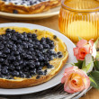 Omelette with blueberries on wooden table. Romantic summer set — Stock Photo