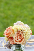 Bouquet of pastel roses in the garden. Copy space — Stock Photo