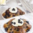 Delicious cake with blueberries, decorated with cream and fresh — Stock Photo