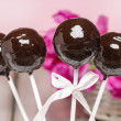 Chocolate cake pops on pink romantic background — Stock Photo