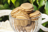 Parisian macarons in glass goblet. Garden party setting — Stock Photo