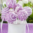 Lilac cake pops in white ceramic jar. White and pink daisies — Stock Photo #29083097