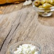 Bowl of cottage cheese on wooden table. Copy space — Stock Photo