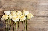 Pastel roses on wooden background. Copy space — Stock Photo