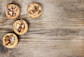 Top view on homemade tarts with dried fruits on wooden table — Stock Photo
