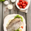 Fried cod on white plate with fresh vegetables and egg — Stock Photo