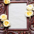 Wooden frame decorated with yellow, pastel roses. Copy space — Stockfoto