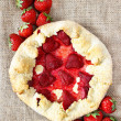 Top view of strawberry galette. Summer pie filled with fruits — Stock Photo #29208763