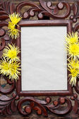 Wooden frame decorated with yellow chrysanthemums. Copy space — Stock Photo
