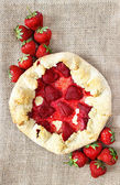 Top view of strawberry galette. Summer pie filled with fruits — Stock Photo