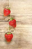 Fresh ripe strawberries on jute background. Copy space. — Stock Photo