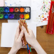 Professional artist holding colorful crayons in her hands. Woman — Stock Photo