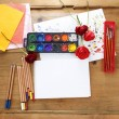 Blank sheet of paper and drawing accessories. Copy space. — Stock Photo #29667961