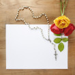Colorful roses and white rosary on wooden background. Blank shee — Stock Photo