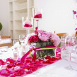Stunning wedding decoration made of pink and red roses. — Stock Photo #29668599