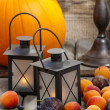 Autumn fruits and traditional lanterns on wooden table. Seasonal — Stock Photo #29866501