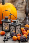 Autumn fruits and traditional lanterns on wooden table. Seasonal — Stock Photo