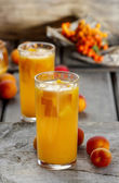 Orange drink on wooden table, selective focus — Stock Photo
