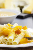 Macaroni with pumpkin sauce — Stock Photo