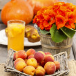 Basket of fresh apricots. Glass of peach juice in the background — Stock Photo