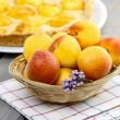 Basket of fresh peaches — Stock Photo