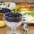 Creamy dessert with blueberries on wooden table. Wooden, rustic  — Stock Photo