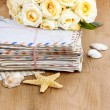Stack of old letters and bouquet of pastel yellow roses on wood — Stock Photo