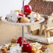 Two level dessert stand full of gingerbread cookies, apples, nut — Stockfoto