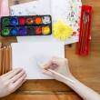 Professional artist painting an chrysanthemum on white paper — Stock Photo