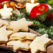 Stock Photo: Homemade cookies in star shape on wooden table in christmas eve