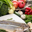 Two raw, fresh rainbow trouts among vegetables. Idea of healthy — Stock Photo