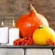 Halloween party decor. Beautiful orange pumpkins on wooden table — Stock Photo