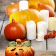 Halloween party decor. Beautiful orange pumpkins on wooden table — Stock Photo #30124079
