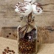 Stock Photo: Chocolate cake pops in jar of coffee beans on hessian